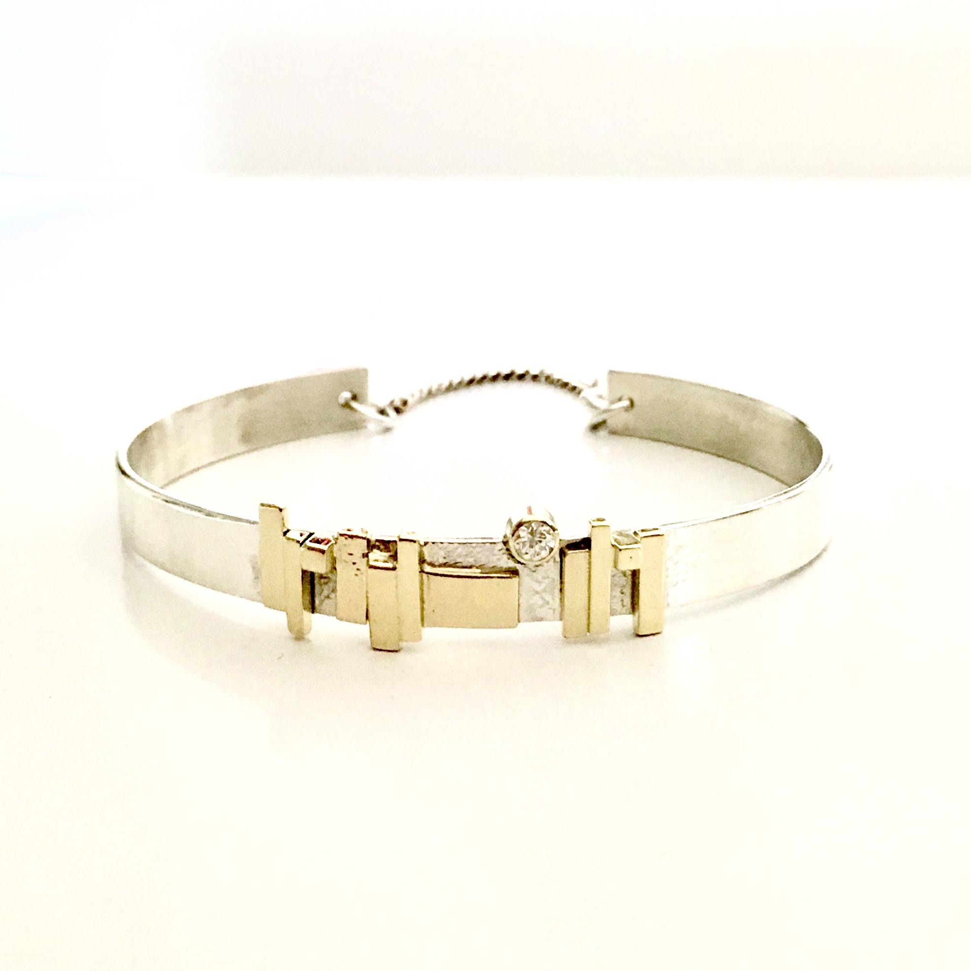 Zilveren armband met gouden plaatjes en diamant